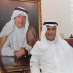 Mr. Mohammed Abdul Latif Jameel pictured with an image of his late father