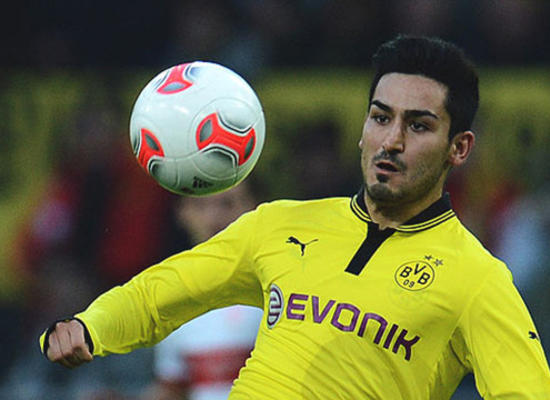 Dortmund's midfielder Ilkay Guendogan eyes the ball as he plays it during the German first division Bundesliga football match Borussia Dortmund vs VfB Stuttgart on November 3, 2012 in Dortmund, western Germany.    AFP PHOTO / PATRIK STOLLARZ DFL RULES TO LIMIT THE ONLINE USAGE DURING MATCH TIME TO 15 PICTURES PER MATCH. IMAGE SEQUENCES TO SIMULATE VIDEO IS NOT ALLOWED AT ANY TIME. FOR FURTHER QUERIES PLEASE CONTACT DFL DIRECTLY AT + 49 69 650050.        (Photo credit should read PATRIK STOLLARZ/AFP/Getty Images)